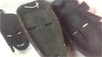A lot of three tribal masks