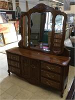 Wooden dresser w/mirror and matching headboard,