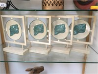 4 metal decorative stands w/shell image on it,