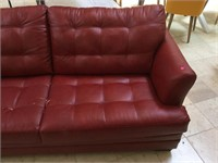 Red Sofa bed, - it's peeling- , approx 77x37