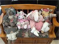 4 plush dolls