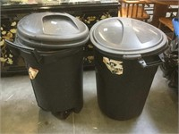 Pair of black plastic trash cans both are 32