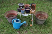 METAL TABLE, ASSORT POTS, WINDCHIME, AND WATERING