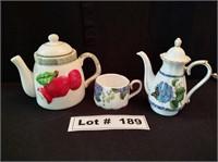 2 COLLECTIBLE TEA POTS - 1 TEA POT WITH A CUP