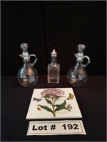 3 DECANTERS AND A TRIVET