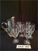 6 STEMED DRINKING GLASSES AND A GLASS PITCHER