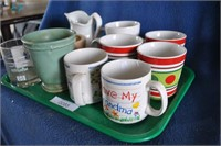 Flat of misc coffee cups, creamers, vase