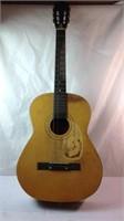 Vintage acoustic guitar needs work