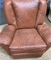 714 - BROWN LEATHER RECLING CHAIR