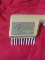 Vintage Sunbeam Beauty Breeze hair straightener.