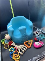 Bumbo seat and baby hand toys and binkis
