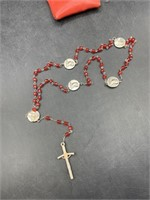 Red rosary with case