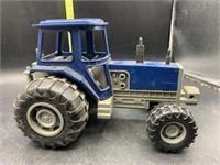 Blue plastic tractor