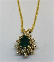 14KT YELLOW GOLD EMERALD AND DIAMOND PENDANT WITH