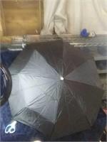 Totes brand black push button umbrella. Godd