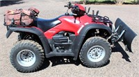 2007 Honda Foreman ES 4-Wheeler - 4x4, TRX 500, 4' front blade, Warn front winch, Mad Dog rear gear bag, 175.5 hrs, 1045 miles, runs good. VIN: IHFTE317X74207077.  NOTE: This item will be sold at live auction, however absentee bids can be placed if you are unable to attend the auction. More details, video & pictures can be viewed by clicking the catalog tab and view Lot #5.