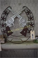 """Iron decor with Double Guns approximately 24""""x24"""