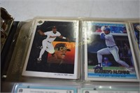 Baseball, Basketball and Football cards in binder