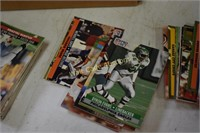 Baseball and football cards unsorted with empty