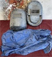 26 -LOT OF WELDING FACE GAURDS & BLUE PLASTIC COAT