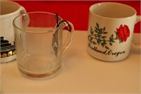 7 COLLECTIBLE SOUVENIR MUGS, NEVER USED