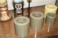 LOT OF CANDLE HOLDERS PLUS CANDLES