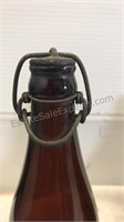 Five Vintage Amber Glass Bottles