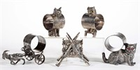 Collection of figural napkin rings and other Victorian figural silver plate