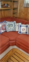 Brick red sectional couch & pillows