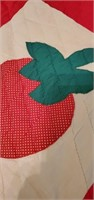 Handmade and hand quilted strawberry quilt this