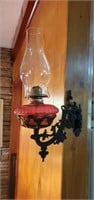 Hanging oil lamp with holder moves from side to