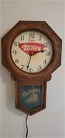 Enjoy Toms delicious snacks advertising clock