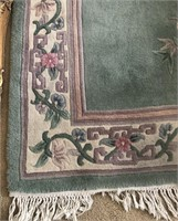 36 - GREEN W/FLOWERS AREA RUG