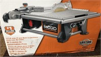 C - NEW RIDGID 7IN TABLE TOP WET TILE SAW