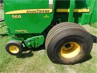 2011 John Deere 568 Mega Wide Plus rd. baler