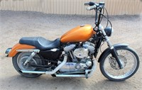 """2008 Harley Davidson XL883 Motorcycle, 39,551 miles, straight pipes, runs great, brand new stator and rectifier, comes w/box of extra parts, excellent """"bar hopping"""" bike, has title.  NOTE: This item will be sold at live auction, however absentee bids can be placed if you are unable to attend the auction. More details, video & pictures can be viewed by clicking the catalog tab and view Lot #6."""