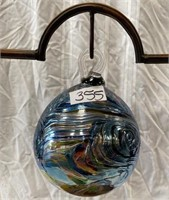 355 - LG BLOWN GLASS BALL HAGNING ON DISPLAY PIECE
