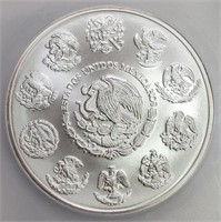 50 - MEXICO FIRST STRIKE SILVER COIN
