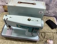 351 - LT BLUE SINGER SEWING MACHINE W/CASE