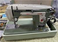 351 - GREEN NEW HOME DELUXE SEWING MACHINE