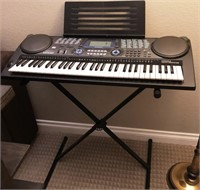 56 - TINKLE THE IVORIES KEYBOARD AND STAND WITH