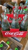 24 COCA COLA BOTTLES AND CARD BOARD COCA COLA BOX