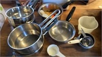 POTS AND PANS AND MEASURING CUPS AND TUPPERWARE