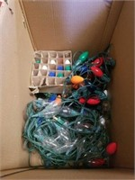 SEVERAL STRANDS OF CHRISTMAS LIGHTS AND