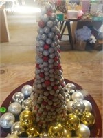 DECORATIVE CHRISTMAS TREE WITH ORNAMENTS ON A