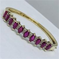 14KT YELLOW GOLD 6.00CTS RUBY AND .20CTS DIAMOND