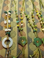 169 - ASSORTED 9 BEADED NECKLACES