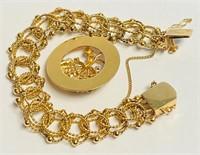 VINTAGE 14 KT GOLD CHARM BRACELET, 31.9 GRAMS.