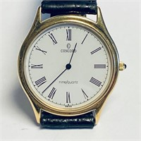 MEN'S 14 KT GOLD CONCORD SWISS MECHANICAL