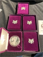 Five silver American Eagle 1 ounce coins all in